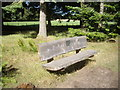 NO7396 : Park bench in Milton Wood by Stanley Howe