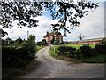 SJ5348 : Farm Entrance on Bickley Town Lane by Jeff Buck