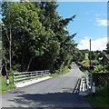SO1068 : Road bridge over a stream, Llanddewi Ystradenni, Powys by Jaggery