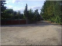 TQ1666 : Surbiton hockey club car park by David Howard