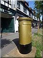 TQ2463 : Golden post box in Cheam by Marathon