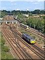 SJ8499 : Train and Tram, North of Victoria by David Dixon
