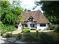 TQ6964 : Cottage next to Pilgrims Road by Marathon
