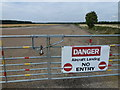 TL1886 : Former runway at Glatton Airbase, Conington by Richard Humphrey