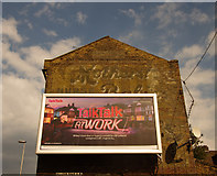 TQ2976 : Ghost sign, Killyon Road by Jim Osley