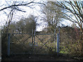 SP0366 : Gates into derelict land behind Evesham Road, Headless Cross, Redditch by Robin Stott