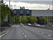 TQ4077 : Overhead Sign Gantry over the A102 near Charlton by David Dixon