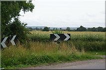 SE3982 : Sharp bend on Sandhutton Lane by Bill Boaden