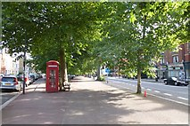 TQ2576 : Phonebox on New Kings Road by DS Pugh