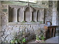 NY9393 : St. Cuthbert's Church, Elsdon - carved stone panel below the west window by Mike Quinn
