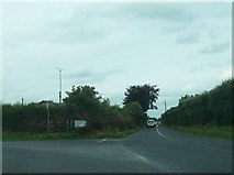N7377 : Minor road junction of the R164 at Whitecommons by Eric Jones