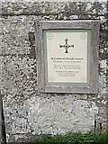 NY9393 : Information plaque on churchyard wall by Stanley Howe