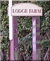 TM1283 : Lodge Farm sign by Adrian Cable