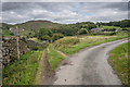 SD2590 : Path and Lane Junction near Hawes by Tom Richardson