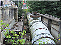 NS5471 : Water supply pipe at Bearsden railway station by Thomas Nugent