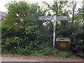 SX7966 : Beaston Cross signpost and grit bin by David Smith