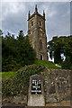 SH5571 : St Mary's Church and milestone by Ian Capper