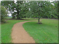 TL6805 : Path in verge of entrance road to Hylands Park by Roger Jones