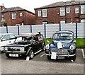 SJ9594 : Morris Minor and Mini Clubman Hearse by Gerald England