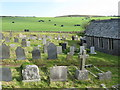 SS7449 : Graveyard and silage field at Countisbury by M J Richardson