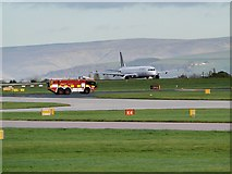 SJ8184 : Jet and Fire Tender, Manchester Airport by David Dixon