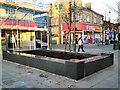 SJ9494 : New Planter in the Market Place by Gerald England
