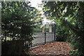 TL1653 : The gates to Tempsford Millennium Garden Sanctuary by Richard Dorrell