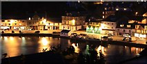 NR8668 : Tarbert harbour and shops by Colin Kinnear