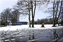 SJ7886 : Playing fields in snow by Anthony O'Neil