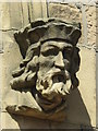 NZ2565 : Jesmond Parish Church, Eskdale Terrace, NE2 - stone head, entrance (2) by Mike Quinn