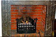 R4460 : Bunratty Castle Hotel - Turf Fire in Lounge Fireplace by Joseph Mischyshyn