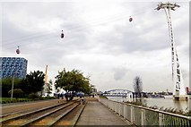 TQ3979 : The Thames Path runs under the Emirates cable car by Steve Daniels