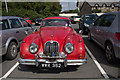 SO2242 : Jaguar in Car Park, Hay-on-Wye by Christine Matthews