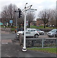 ST1377 : Black-gloved signpost arms, Fairwater, Cardiff by Jaggery