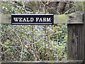 TL2259 : Weald Farm sign by Adrian Cable