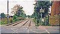 TQ2569 : Croydon Tramlink: Kingston Road level-crossing and Merton Park tram-stop, 2000 by Ben Brooksbank