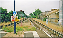 TQ2567 : Towards Wimbledon from Morden South station, 1999 by Ben Brooksbank