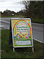 TL2756 : Greenfields Day Nursery sign on Caxton Road by Adrian Cable