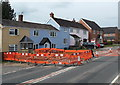 SO7219 : Orange barriers around A40 roadworks in Huntley by Jaggery