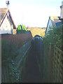 NU2419 : Footpath between houses, Dunstan by Karl and Ali