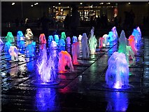 SJ8498 : Piccadilly Gardens Fountains at Christmas (7) by David Dixon