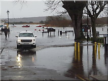 SZ1592 : Christchurch: driving through floodwater at Town Quay by Chris Downer
