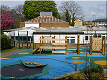 TQ2274 : School play area by Robin Webster