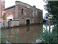SE6051 : The Bonding Warehouse, York. Derelict and flooded by Christopher Styles