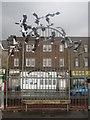 SD4364 : Birds above a bench, Morecambe promenade by Graham Robson