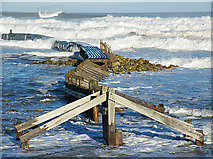 NJ2370 : Old Breakwater by Anne Burgess