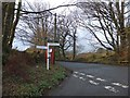 SX2382 : Signpost and phone box at Lower Tregunnon by David Smith