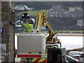 SW5240 : St. Ives: fixing a light on Smeaton's Pier by Chris Downer