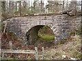 NH5650 : Old railway bridge, in Spittal Wood by Craig Wallace