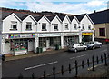 ST0597 : Row of white shops, Penrhiwceiber by Jaggery